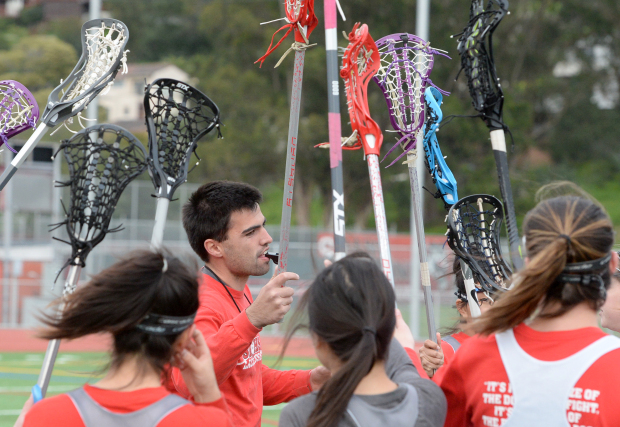 Jeremie Brunet, head coach of the San Rafael girls varsity lacrosse team, talks to the players during practice in San Rafael on Tuesday. (Alan Dep/Marin Independent Journal)